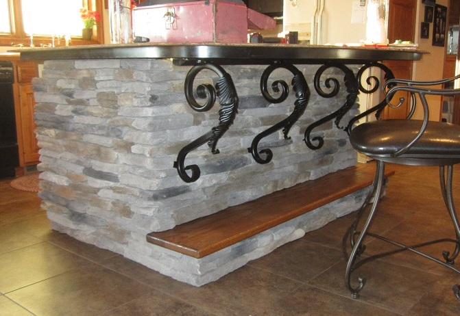 A Bar Top Carried By Bronze Finished Angle Brackets By Shoreline Ornamental  Iron